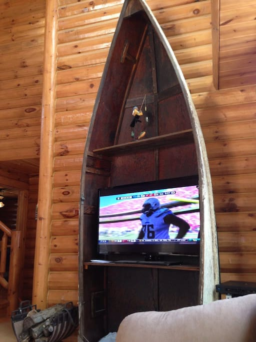 Canoe turned into an entertainment center in the main cabin area.