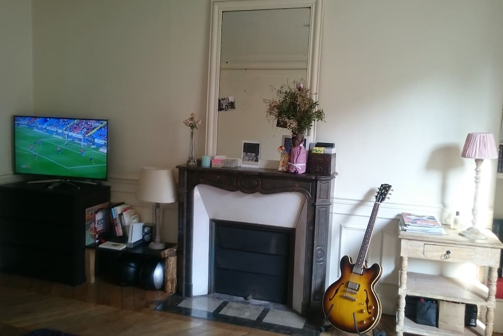 The living room with 105cm TV and functional chimney