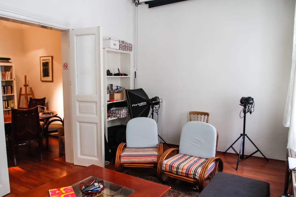 in a part of the living room there are some of my photography staffs