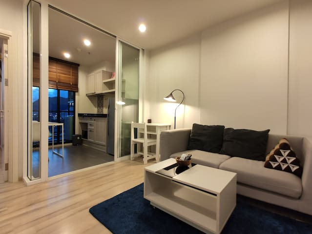 The sliding glasses doors divided the dining area and the kitchen from the living area.
