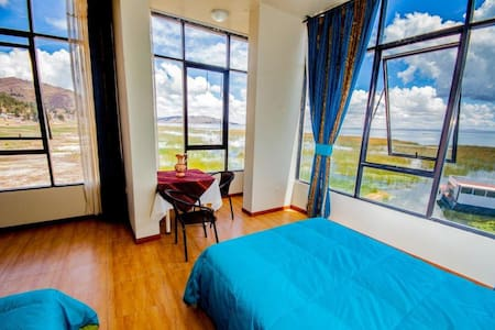 We are located 12 km from downtown Puno, on the shore of the Lake Titicaca, we have comfortable rooms with privileged views of Lake Titicaca, spectacular and wonderful scenery and excellent service will make your stay an unforgettable experience.