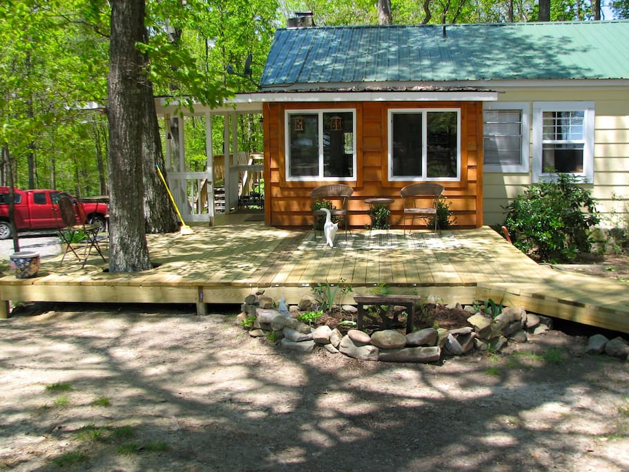 The spacious front deck is perfect for enjoying the peace and quiet under gorgeous, mature trees.