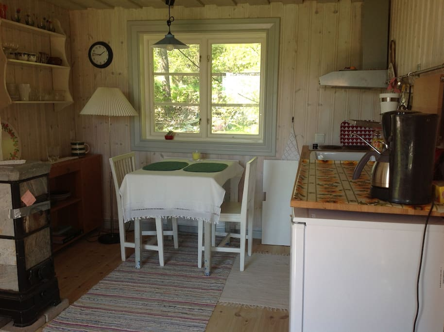 The kitchen with a place to make food and eat. You can order breakfast from us if you want.