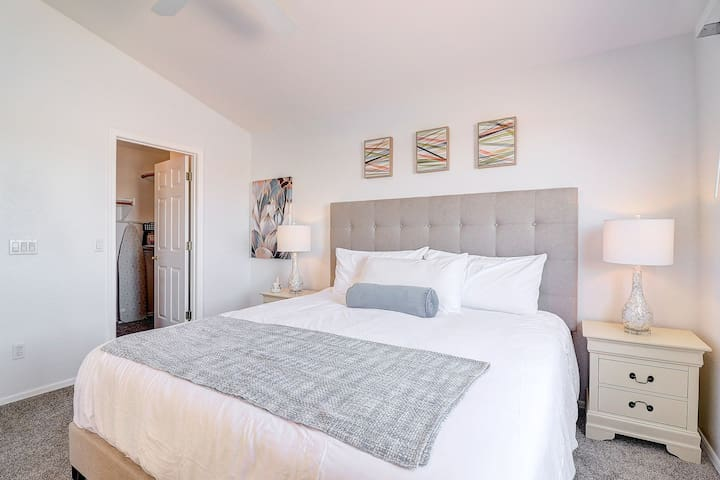 master bedroom. king bed. two nightstands and chest of drawers with walk in closet. doors lock for privacy