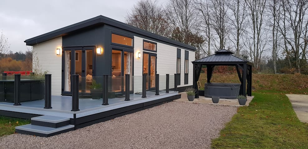 SILVERDALE LODGE, with private hot tub.