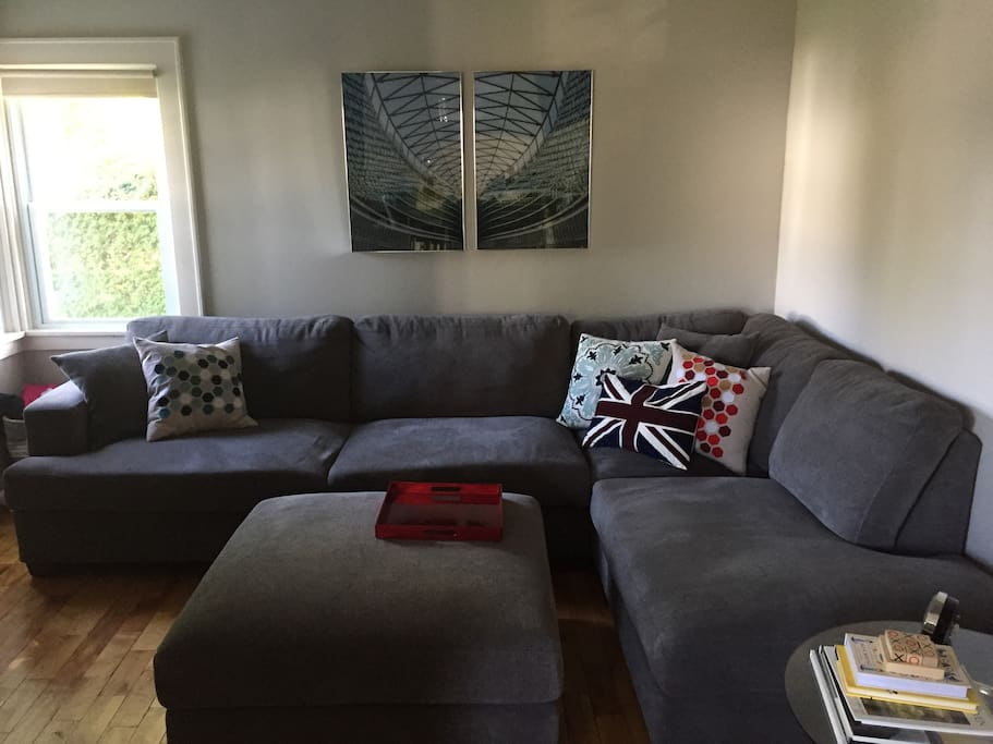 "The living room has a 42"" TV and a large, comfortable sectional couch to relax on."