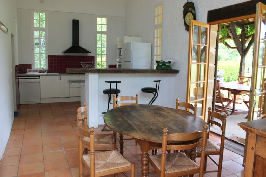 Large family kitchen with breakfast bar, dining area and access to terrace