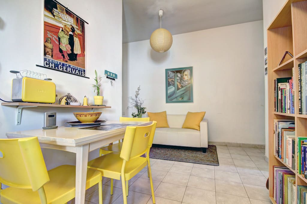 sitting area with dining table and yellow toaster...:)