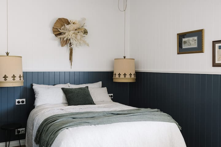 Master bedroom with luxurious linen bedding and epic vintage light shades