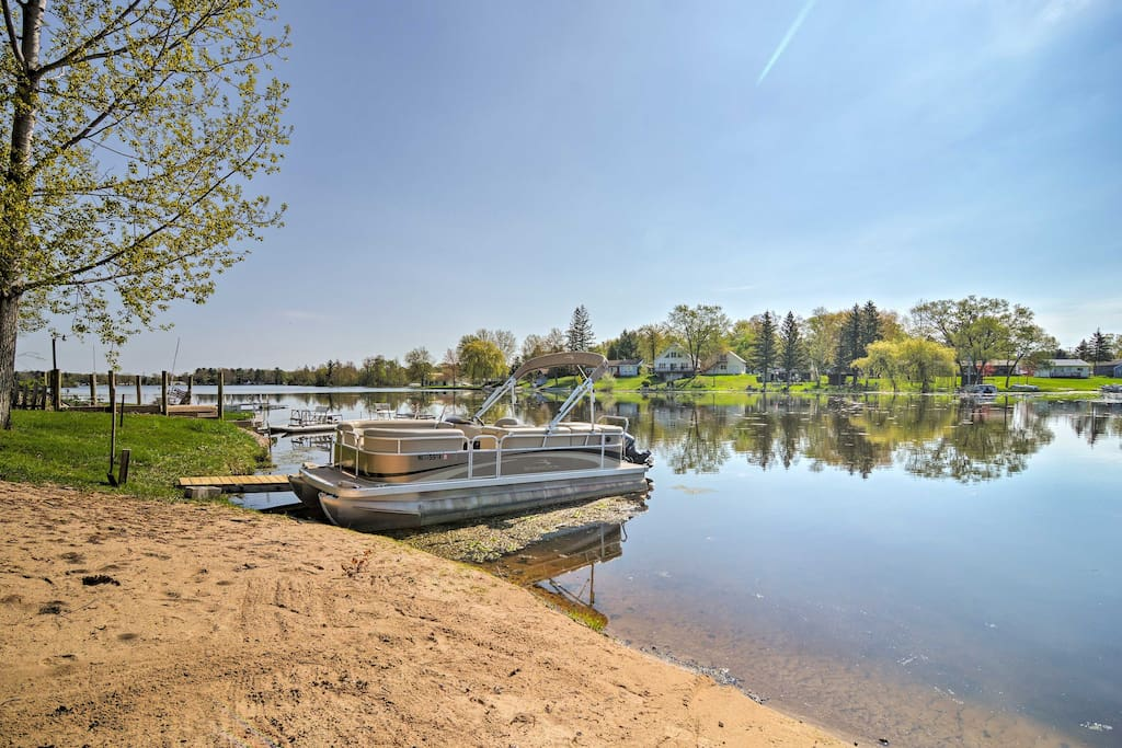 Take the pontoon out for the day during your stay at this vacation rental house on Lake Wiggins!