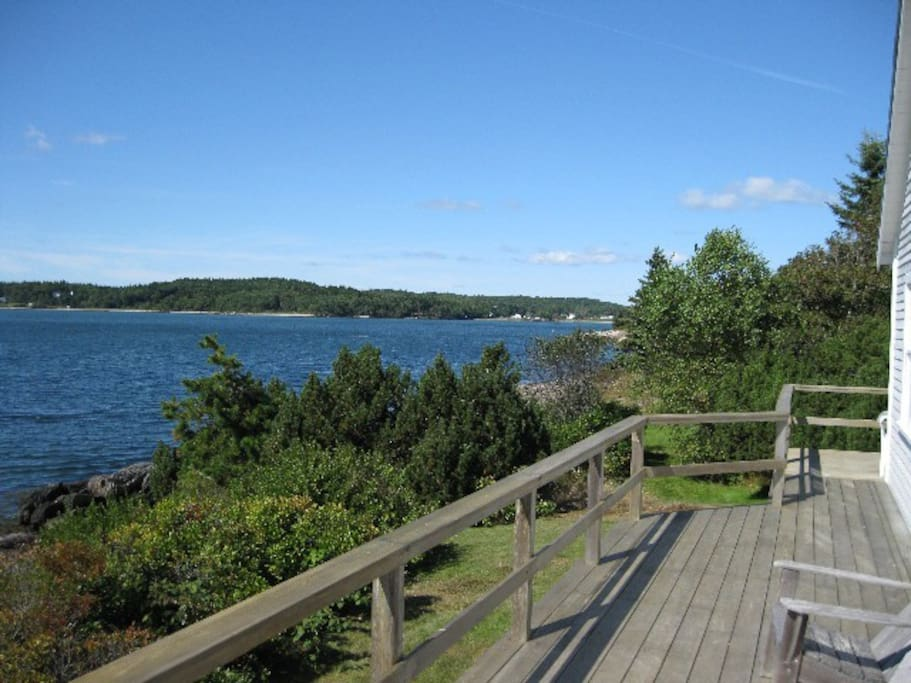 Deck on West side, looking north where a sandy beach beckons at low tide.
