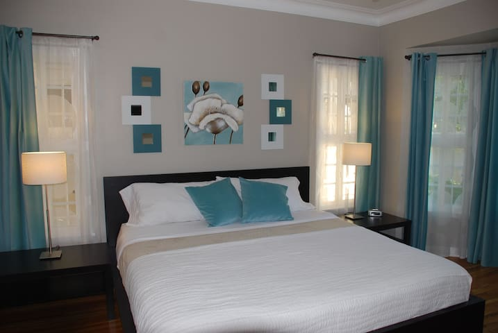 The blue bedroom features a King size bed and iphone dock/ alarm/ clock with nature sounds.