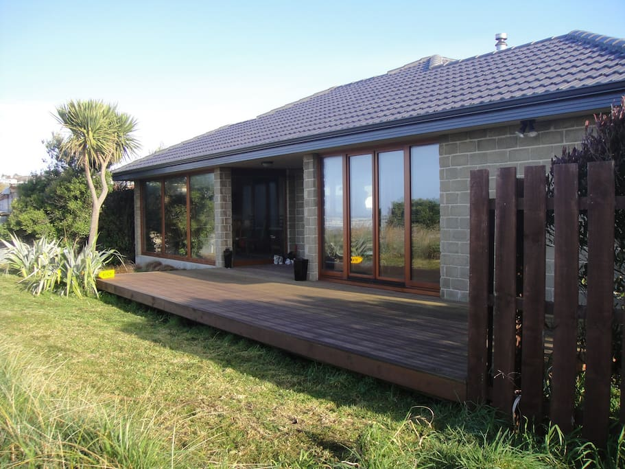Listen to the Sound of Surf, with a large deck area to enjoy plenty of coastal Otago sunshine
