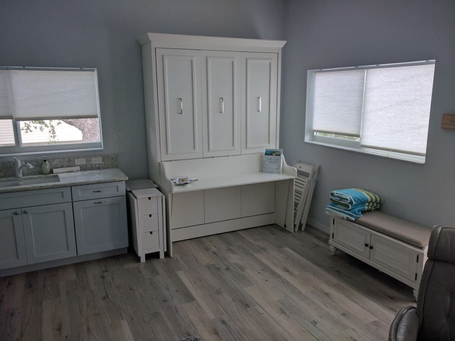 Desk converts to a queen sized bed. Brand new! Simply pull the handles forward to reveal the bed. No need to remove items from the desk.