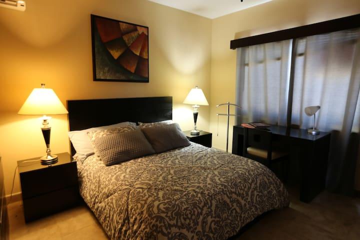 Queen size bedroom with complete bathroom