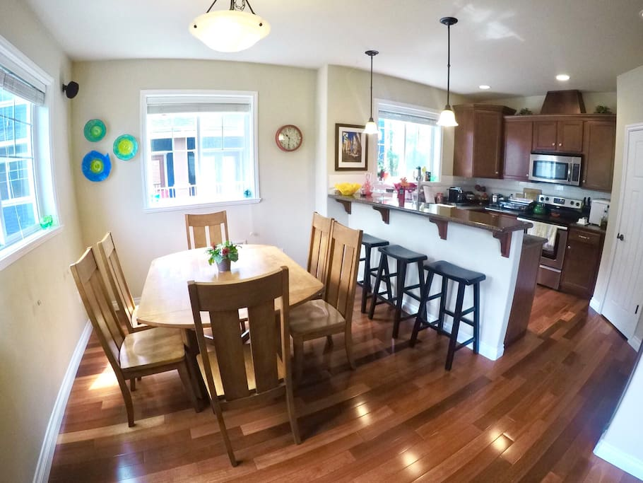 Modern kitchen, and dining area that can seat 4 to 8 people