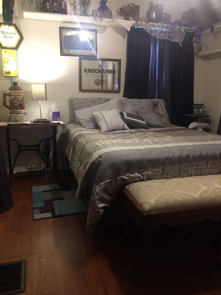Large eclectically decorated bedroom with brand new queen bed, along with, all new bedding and linen.