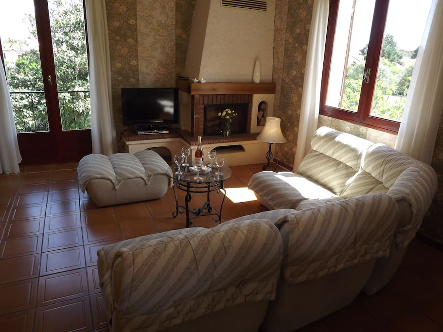Comfortable sitting room, ideal for summer or winter with Log fire and air conditioning.