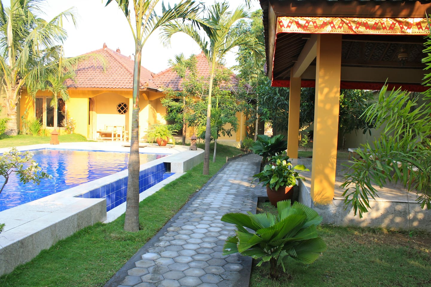 view from the terraceof your room, overlooking swimming pool,tropicalgarden, and gazebo.