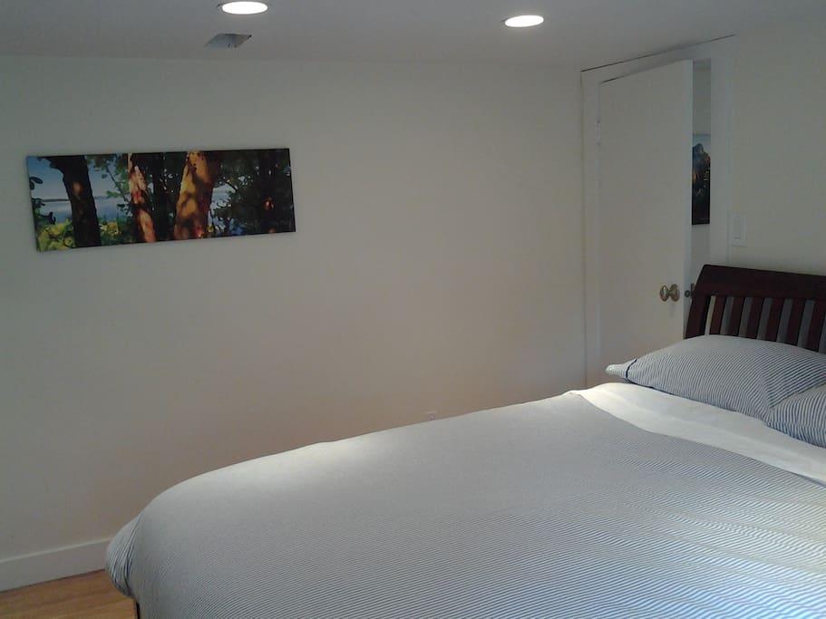 Peaceful bedroom with very comfortable queen bed.