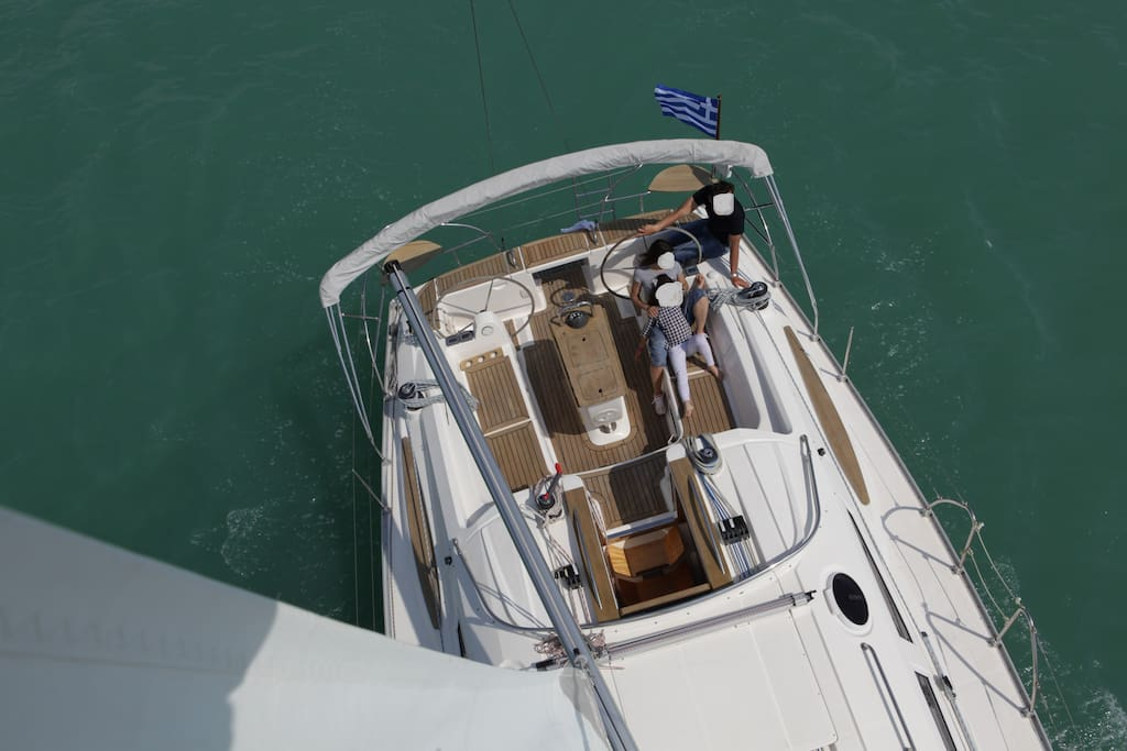 Enjoy the Greek sun and light breeze on the deck of our wonderful sailing lady