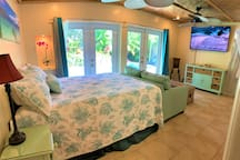 Large master bedroom opens up to tropical oasis with waterfall and private pool