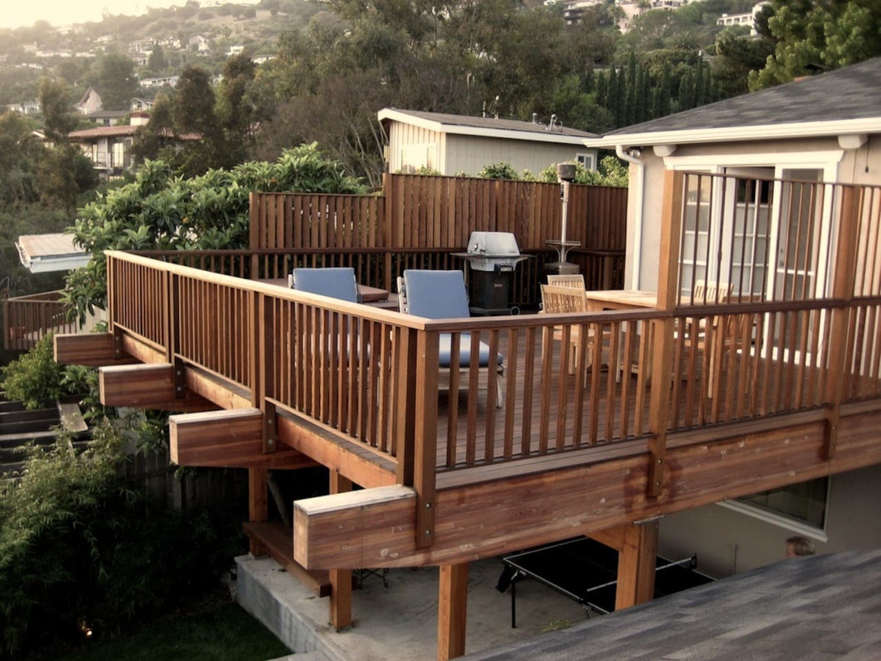 View of rear deck and house. Rental is upper level (street level) with deck. Ping pong below no longer exists and lower level is our private residence and not included.