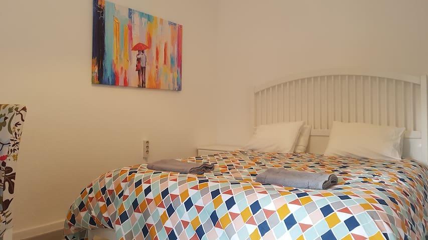 Bed & Shower - Queen Bedroom with Shared Bathroom