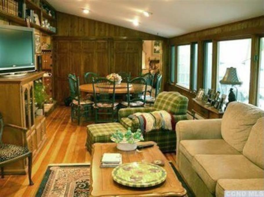 family room with large TV and dining room