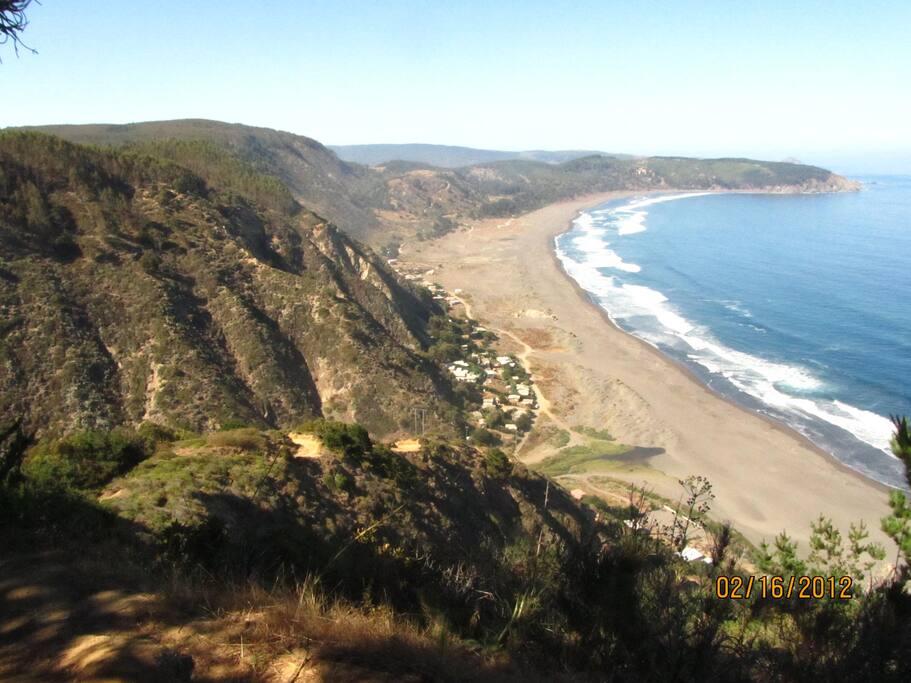 The view of the beach from above the mountain range (Cordillera de la Costa) north to south