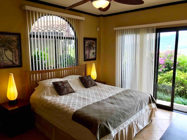 A luxurious King bed is within a spacious ensuite room leading directly into our mature gardens filled with birds, and our rainforest boundary