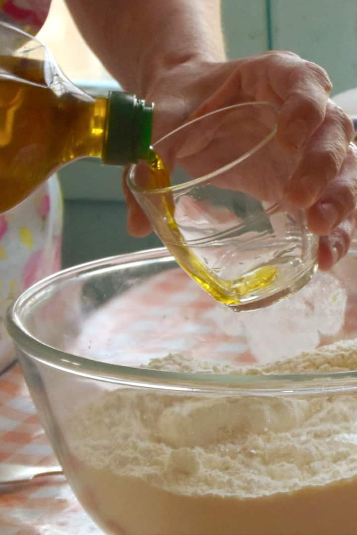 Mixing olive oil pastry