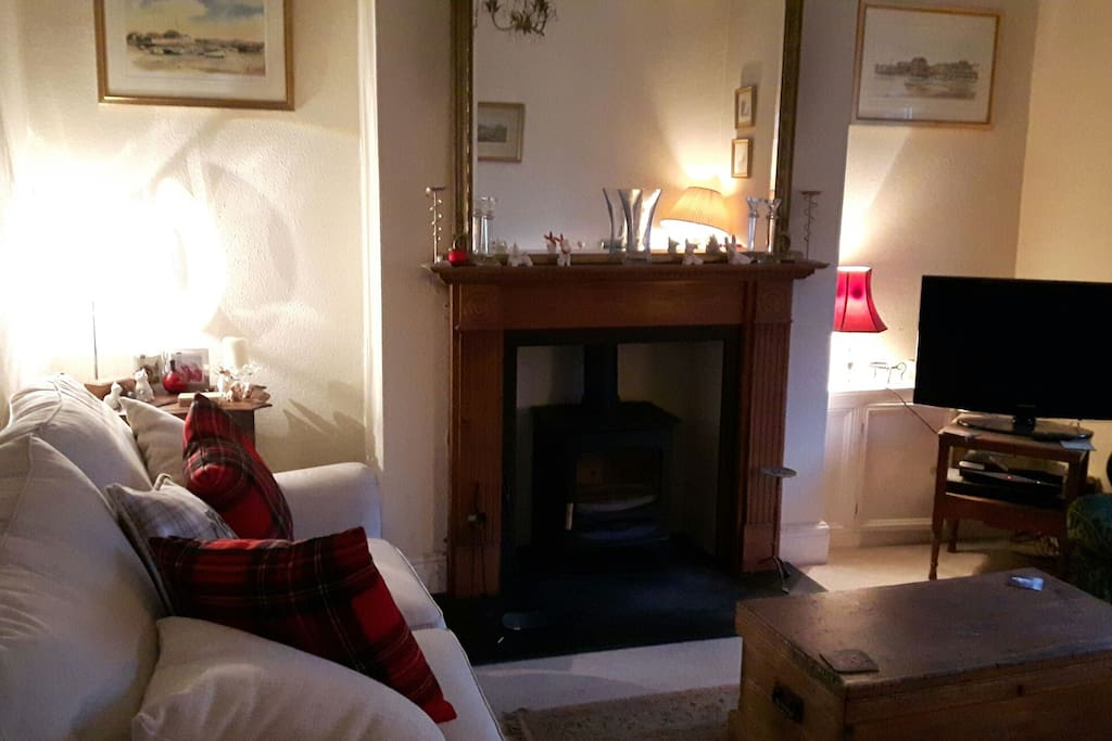 Cosy feel in the sitting room, added to that a log burner.