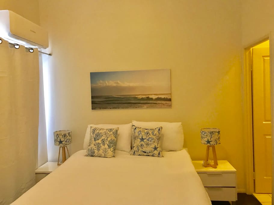Air conditioned ensuite bedroom with queen size bed for two people, private bathroom and private balcony.