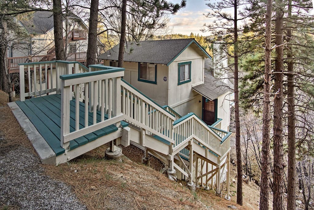 This serene cabin home accommodates up to 12 guests and rests just over a mile from the Lake.