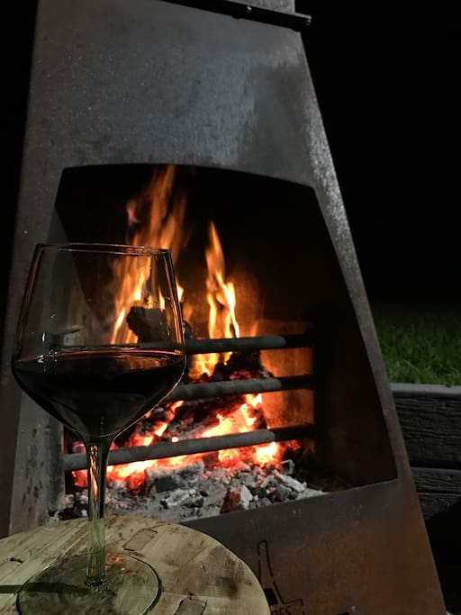 Enjoy a glass of wine around this amazing outdoor fire