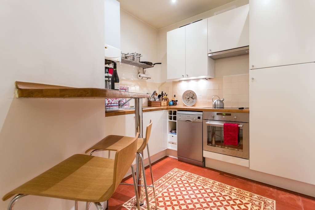 well-equipped kitchen with provencal tiles
