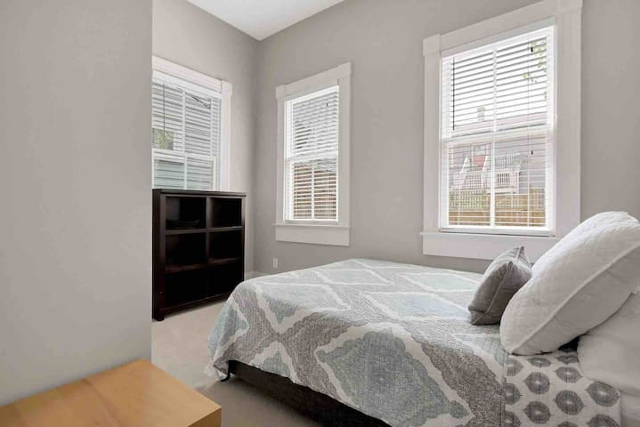 The Queen-sized bedroom is bright and inviting.
