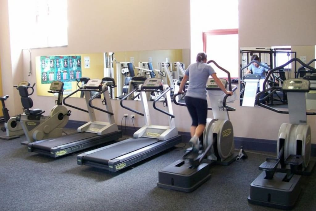 Well equipped communal gym with cardio and weight machines