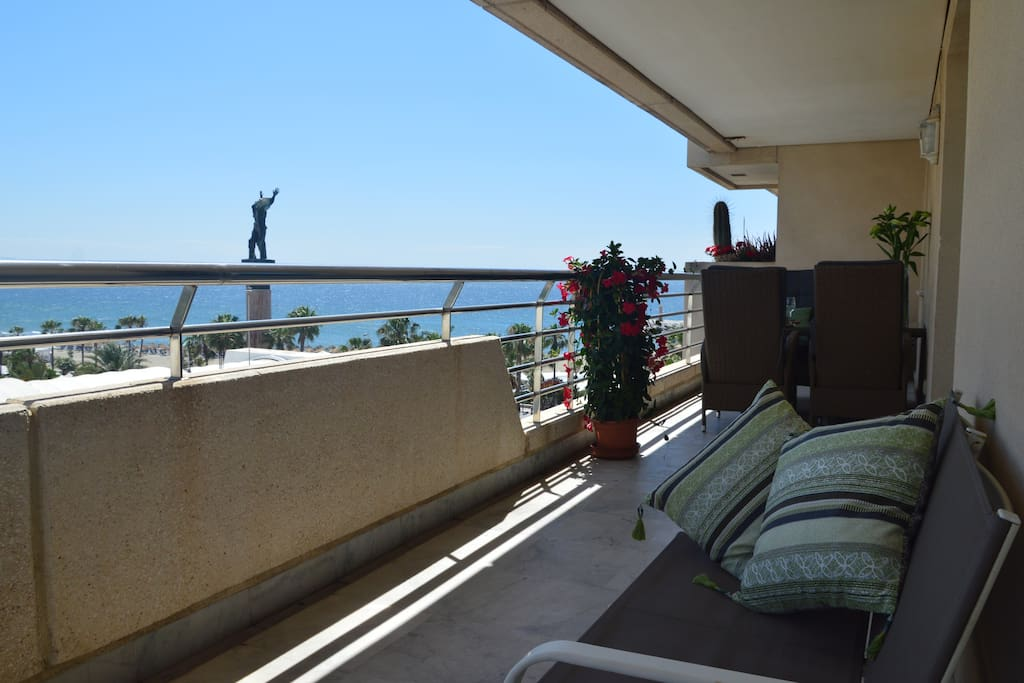 Large terrace with several lounge areas. Seaview.