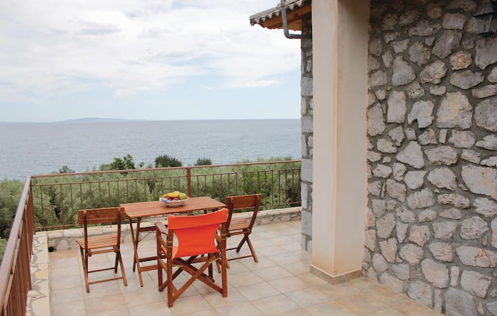Nice home in Andreas Paralio with 2 Bedrooms and WiFi