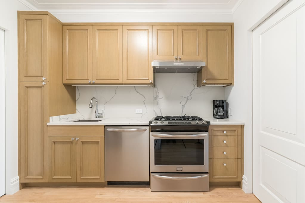 Brand new custom built cabinetry and high end appliances.