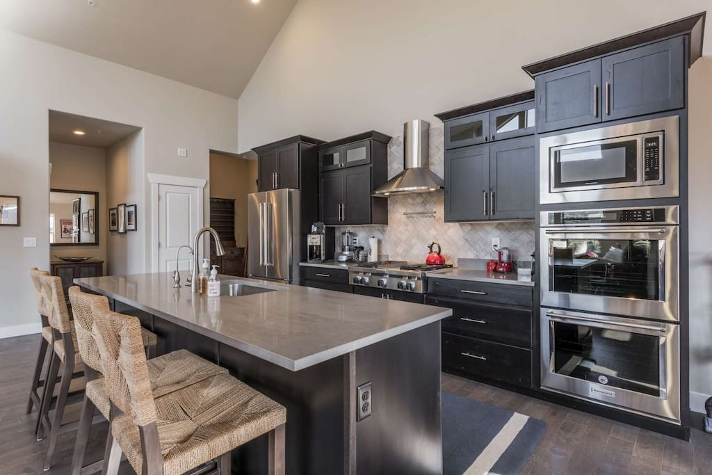 The chef's kitchen features all new stainless steel appliances including refrigerator, 2 ovens, gas stove, dishwasher, microwave and more.