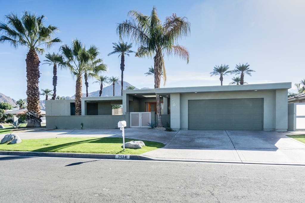 Drive through the quiet and classy Indian Wells neighborhood, adorned with palm trees and desert landscaping