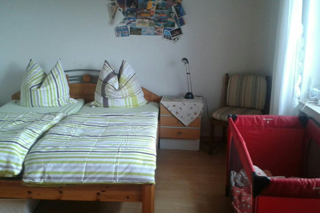 Kingsize bed with an additional cot