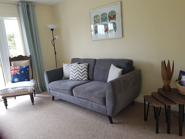 Our living area is light, airy and spacious with double doors leading to the garden
