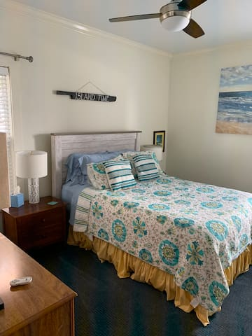 Bedroom has a very comfortable queen bed. A great place to sleep after a fun filled day in Carolina Beach
