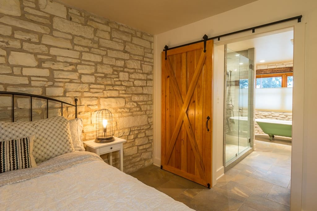 Beautiful barn door leading to master bath