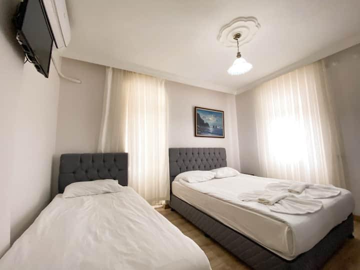 Üç kişilik konforlu hijyenik oda