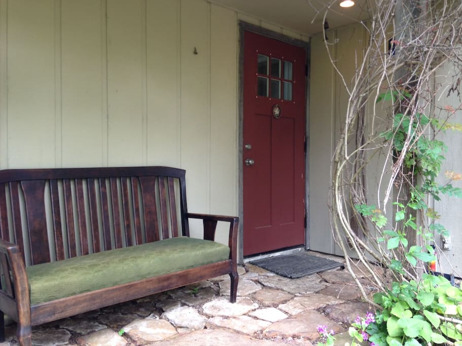 Rustic rock porch, couch and arts and crafts entry door
